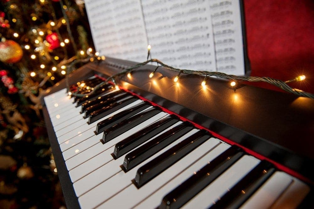 Piano Decorated With Christmas Lights
