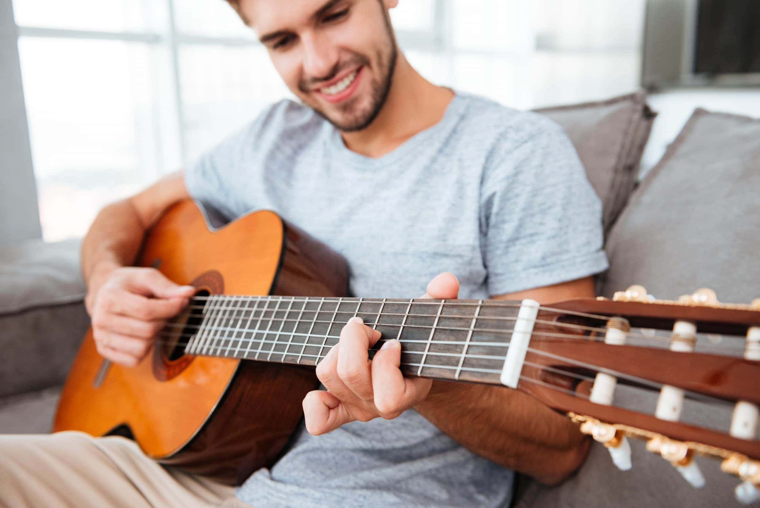 Playing the guitar while sitting