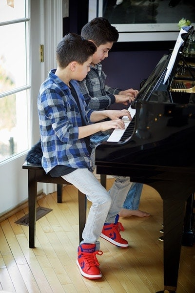 Private Piano lessons in NYC. Twins playing piano