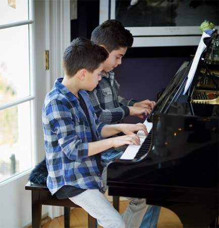 Music to Your Home. Twins playing piano.